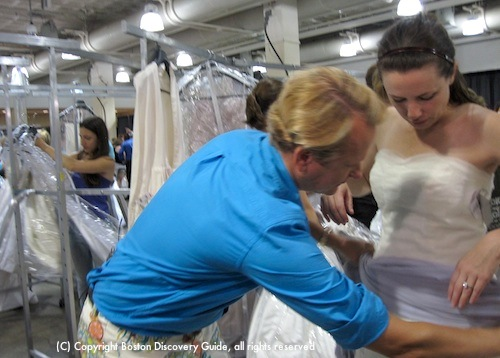 Photograph of team cheering their success in finding the perfect wedding gown / www.boston-discovery-guide.com