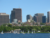 Photo showing Beacon Hill, Downtown Boston, and sailboats on Charles River / Cruises from Boston to Europe - www.boston-discovery-guide.com