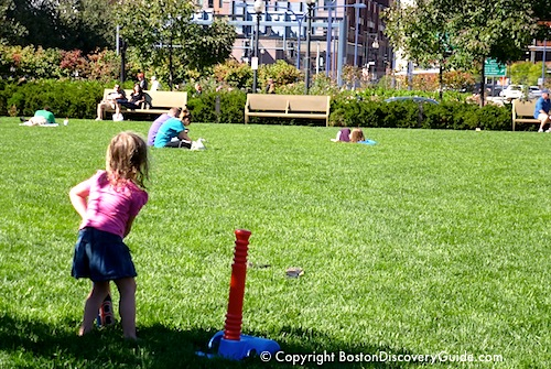 Child playing on Boston's Greenway