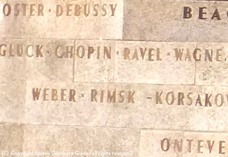 Close-up photo of composers' names etched into the front of the Hatch Shell