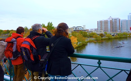 Spectators watching Head of the Charles Regatta from the BU Bridge