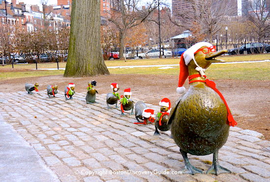 Make Way for Ducklings statues dressed in Santa hats
