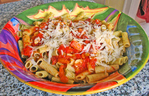 Photo of pasta with homemade marinara sauce and grated cheese