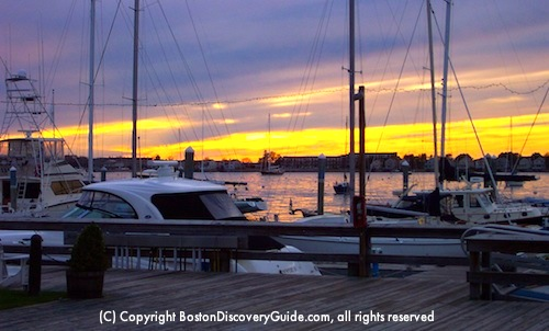 Photo of sailboats in Newport's harbor in early evening / Things to Do in Boston in May - www.boston-discovery-guide.com