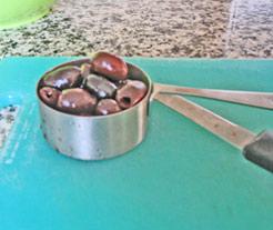 Kalamata olives ready to chop