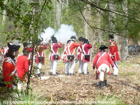 Redbacks returning fire from Minute Men, who have ambushed them while hiding on a hilltop as payback for the Lexington Minutemen who the British killed earlier on their way to Lexington