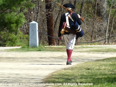 Minute Man walking down Battle Road after ambushing the British at Parkers Revenge - BostonDiscoveryGuide.com