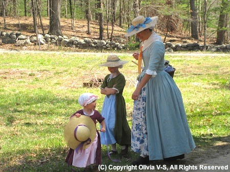 Colonial mother and children reenactors - Patriots Day Reenactment in Minute Man National Historic Park