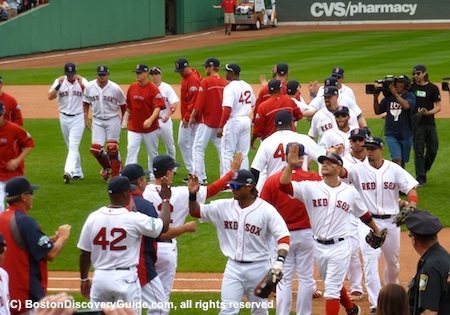 Red Sox give high fives after winning