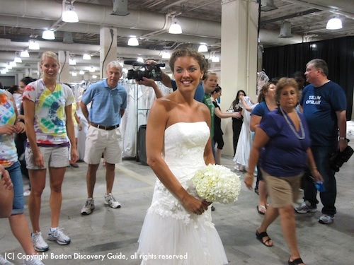 Wedding dress with bouquet at Running of the Brides in Boston
