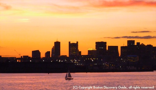 Boston skyline at sunset on Spirit of Boston cruise