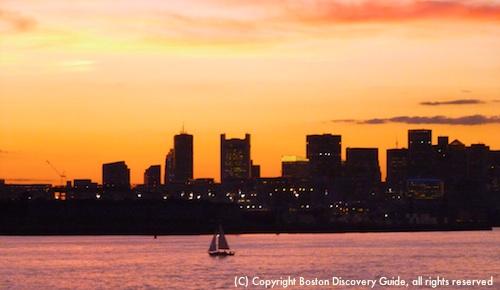 Boston skyline at sunset on Spirit of Boston cruise