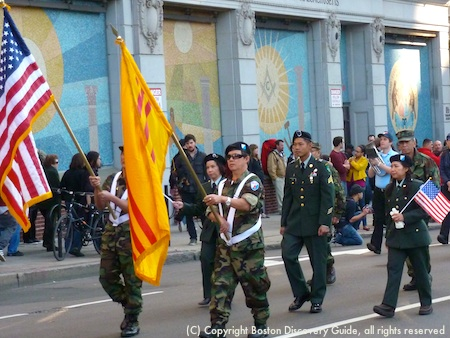 Veterans carrying American and South Vietnamese flags in Boston Veterans Day Parade