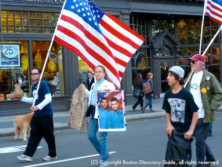 Boston Veterans Day Parade marchers carrying reminders of the costs of war