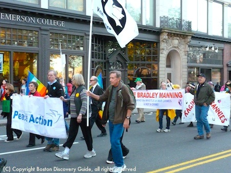 Marchers carrying Peace Action sign in Boston's Veterans Day Parade
