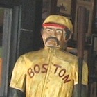 Photo of Red Sox player wooden statue in McGreevys 3rd Base Saloon near Fenway Park in Boston / Boston Sports Tickets - www.boston-discovery-guide.com