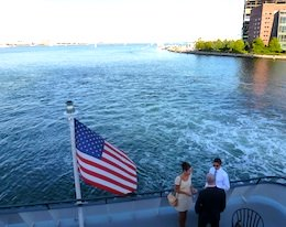 View from observation deck of Odyssey cruise ship leaving Boston Harbor