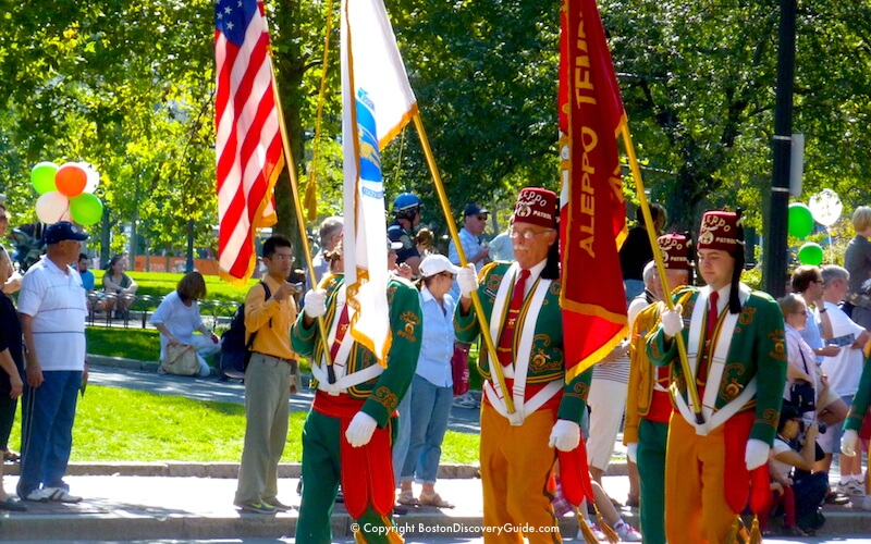 Columbus Day Parade marchers at the edge of Christopher Columbus Park