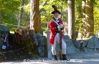 Colonial reenactor near Concord's Old North Bridge in the Minute Man National Historic Park