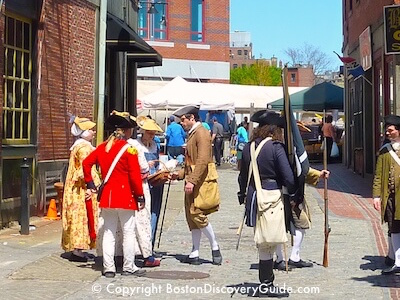 Costumed reenactors in historic Downtown Boston