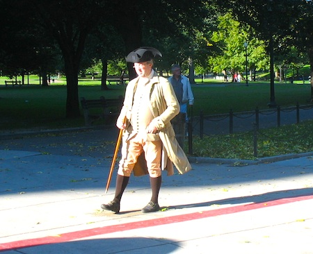 Photo of tour guide on Boston Common wearing Colonial clothing