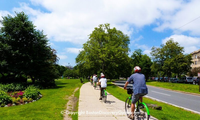 Bike riders in Boston's Fenway neighborhood, near the famous Victory Gardens