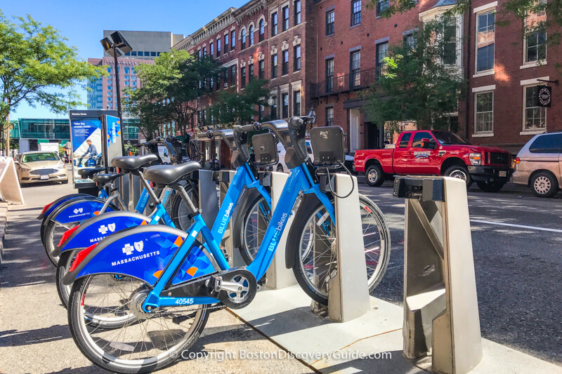 Rack of Blue Bikes on Charles Street in Beacon Hill
