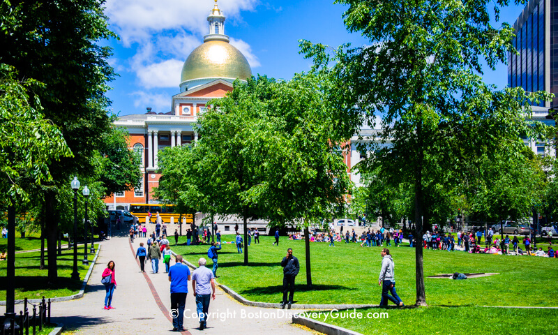 The red stripe marks the Freedom Trail as it leads across Boston Common up to the Massachusetts State House