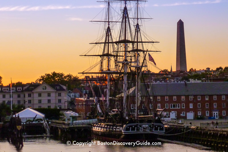 """Bunker Hill Monumentin Charlestown, with the USS Constitution (""""Old Ironsides"""" in the foreground"""