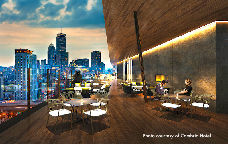 Rendering of rooftop deck overlooking the Boston skyline at Cambria Hotel