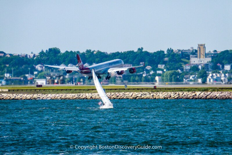 Virgin Airlines flight landing at Boston Logan Airport across from Castle Island