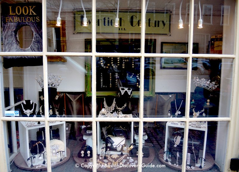Deco, vintage, designer, costume, and fanciful jewelry in shop window on Charles Street