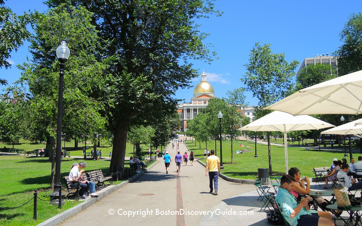 The red stripe of the Freedom Trail leading from Boston Common to the gold-domed Massachusetts State House in Beacon Hill