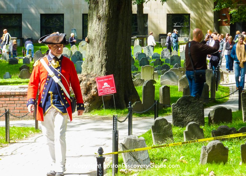 Costumed Freedom Trail tour guide in historic Granary Burying Ground