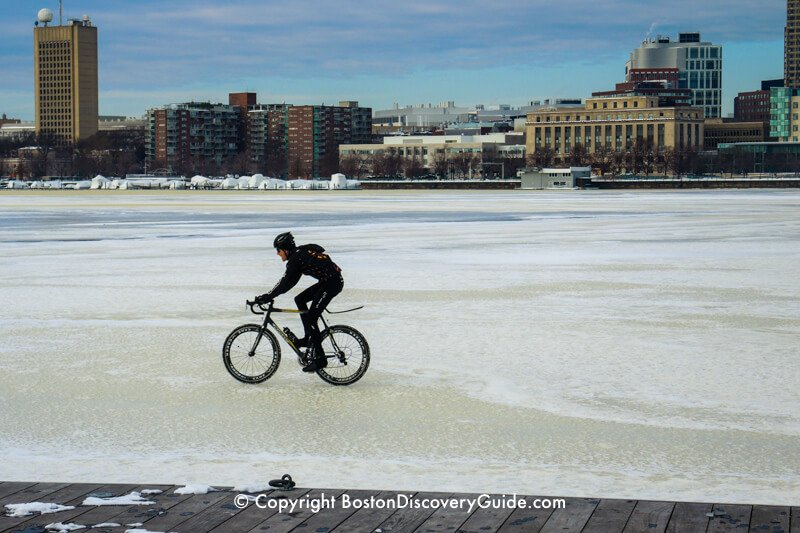 Riding a bicycle across the frozen Charles River
