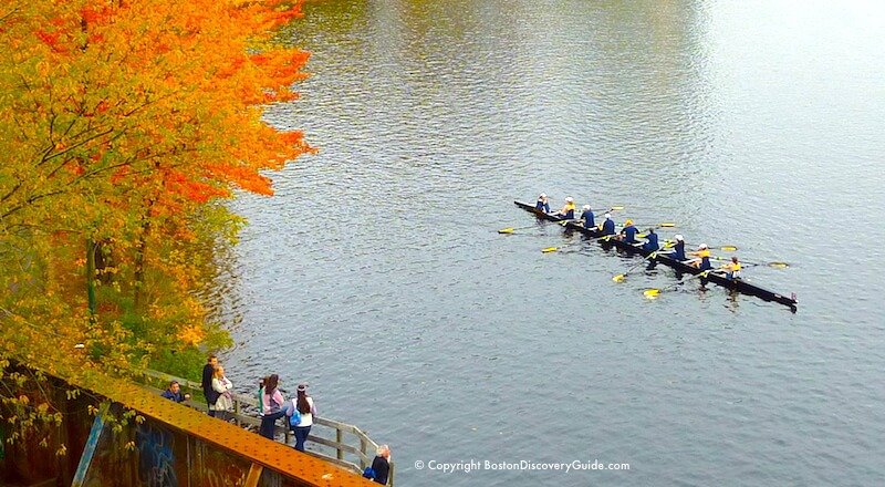 Spectators watch the Head of the Charles from the ramp up to the Boston University Bridge