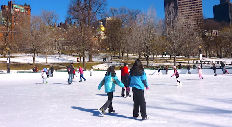 Ice skating on Frog Pond in Boston - one of the best outdoor winter activities in Boston!