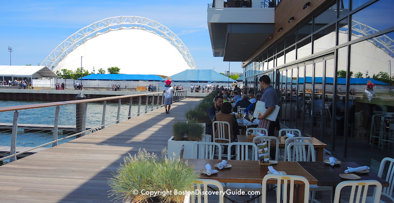 Tables overlooking Boston Harbor at Legal Harborside