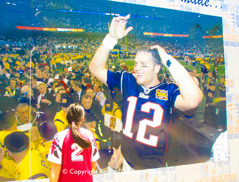 Giant wall mural showing Tom Brady at Patriot Place, next to Gillette Stadium