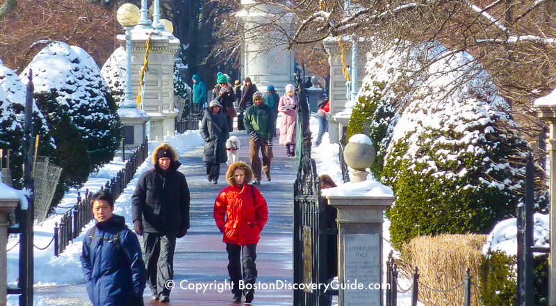 January scene:  Walking across the snow-covered footbridge in Boston's Public Garden