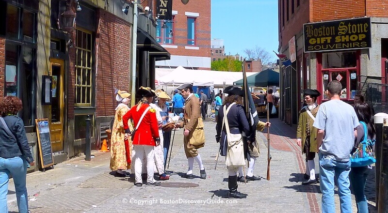 Reenactors in Colonial clothing on Hanover Street in historic Downtown Boston