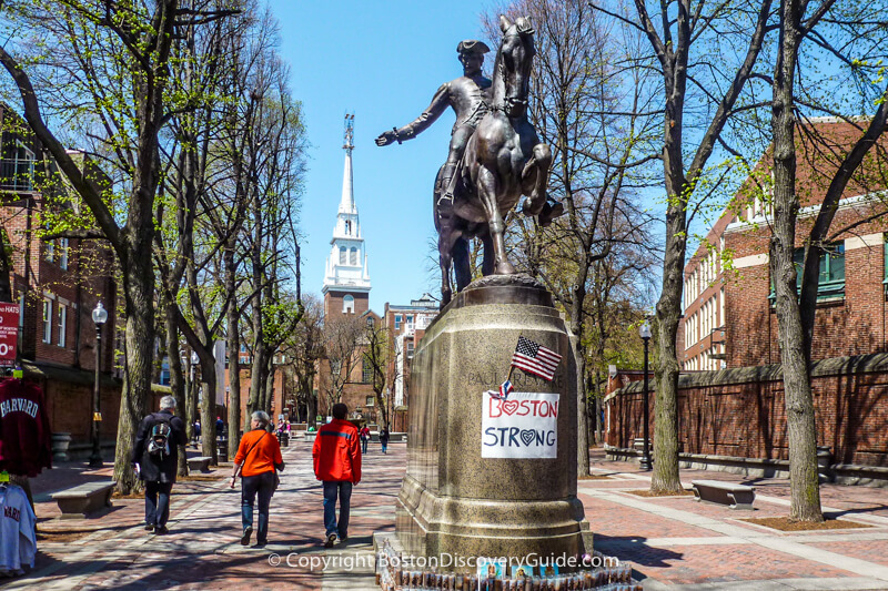 """Paul Revere statue in """"The Prado"""" in Boston's North End, with the Old North Church in the background"""