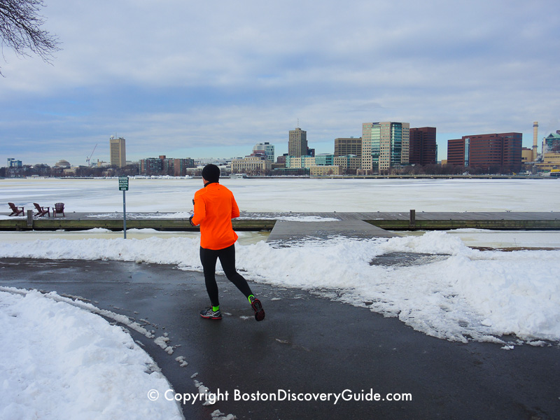 Winter walking tour of Boston: Jogger along the Esplanade, next to the frozen Charles River