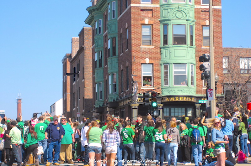 Crowds watching the St Patrick's Day Parade on West Broadway