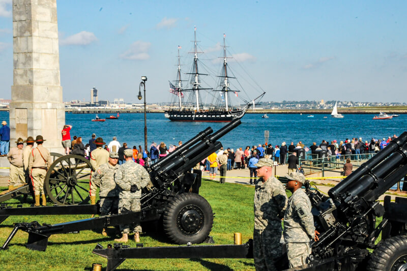 Viewers at Castle Island watching the USS Constitution's turn-around cruise on July 4th