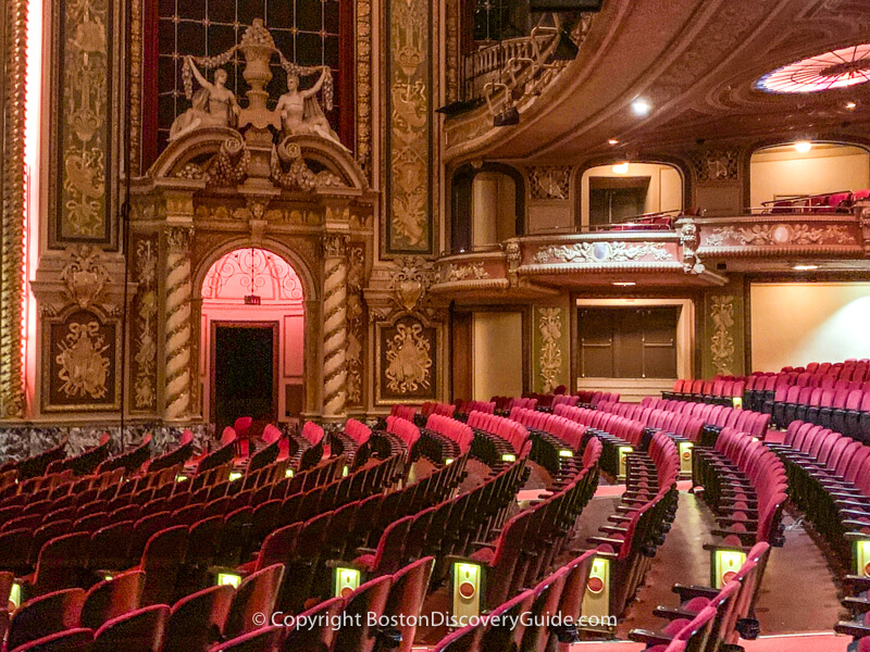 Ornate columns, frescoes, and sculpture at the Wang Theatre