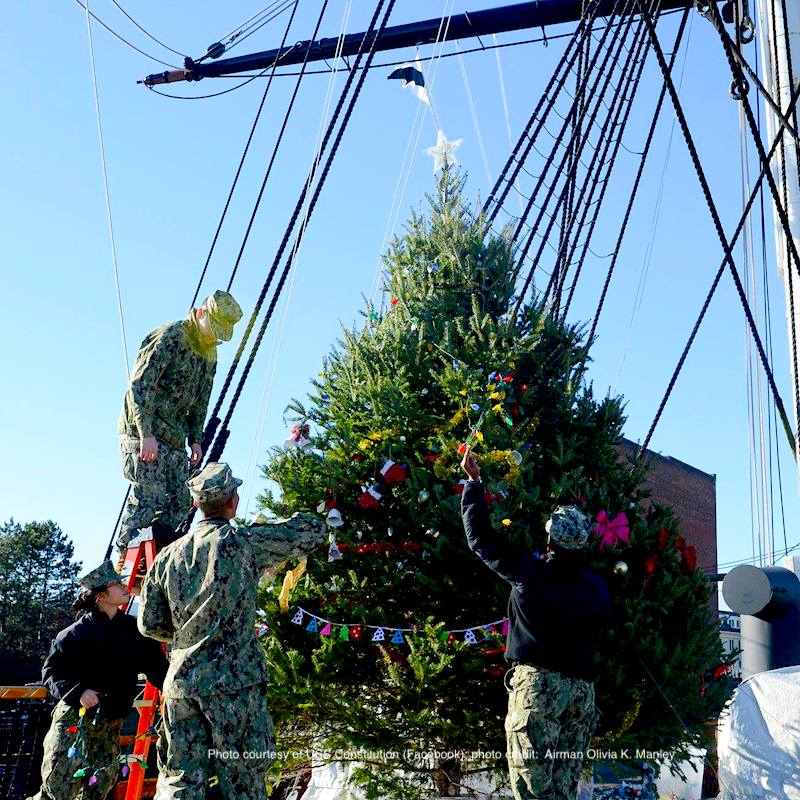 Sailors assigned to the USS Constitution decorate Old Ironsides' Christmas tree before the lighting ceremony
