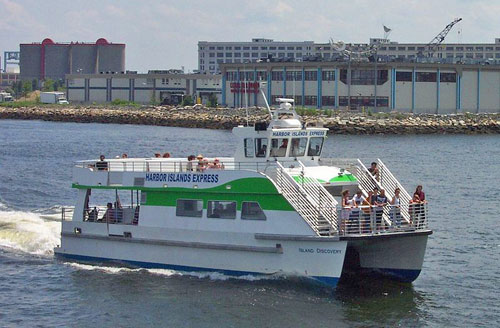Boston Harbor Islands cruise ferry leaving Long Wharf - Aquarium at the left and Marriott Long Wharf Hotel in background - (c) 2006 Chris Woods