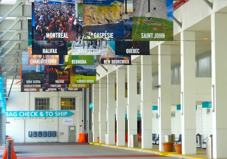 Photo of sign point to Boston luggage storage lockers at Black Falcon Cruise Terminal - www.boston-discovery-guide.com