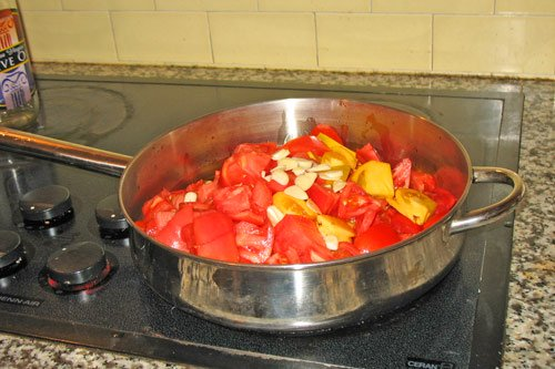 Tomatos, garlic, and olive oil in skillet for homemade tomato sauce